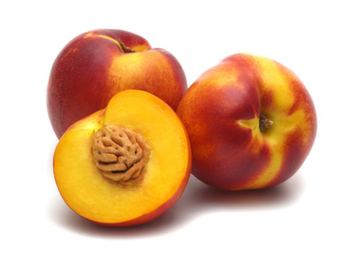 three fresh nectarines on white background
